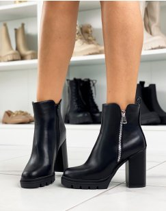 Black ankle boots with heel and silver zip detail