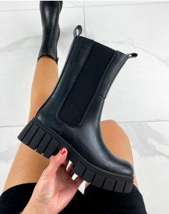 Chelsea boots noires montantes à semelle talonnée