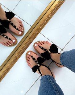 Nu-pieds noirs à nœud et détails dorés