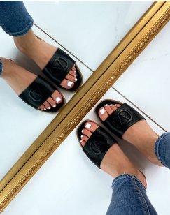 Sandales plates noires à lanière épaisse