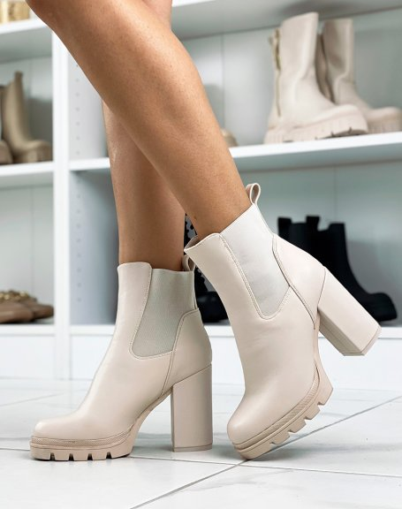 Beige heeled ankle boots with notched platform