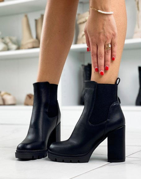 Black heeled ankle boots with notched platform