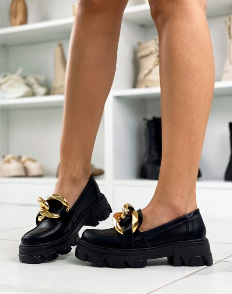 Black loafers with double golden buckle and notched sole