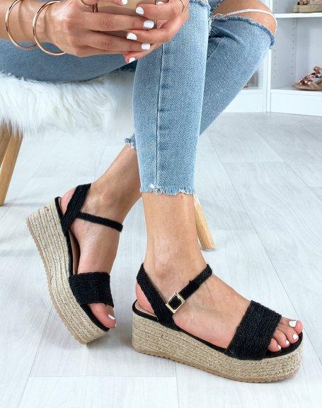 Sandales compensées noires à brides larges tressées