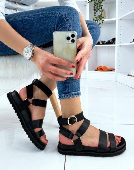 Sandales noires à multiples brides et boucles dorées