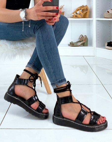 Sandales plates noires avec lacets chevilles