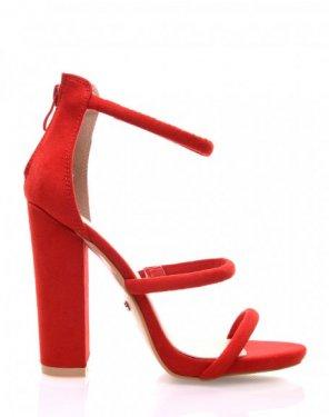 Sandales rouges en suédine et à talons épais