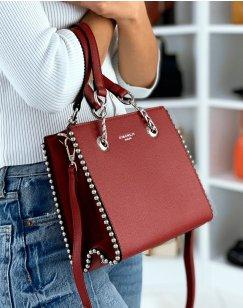 Studded red handbag