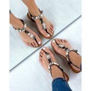 Nu-pieds noirs à coquillages et perles