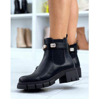 Black Chelsea boots adorned with jewels