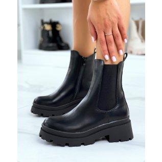 Chelsea boots noires montantes à talon et semelle crantée